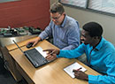 Powell Tronics' Andre Joubert trains Siyabonga Mbeleka on the ATOM suite of products.